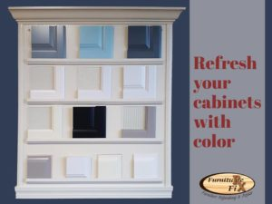 Kitchen cabinet refinishing samples, glass doors, and paint samples.